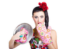 Surprised pinup woman cook Stock Photo