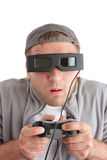 Surprised player with joystick and 3-D glasses Royalty Free Stock Photography
