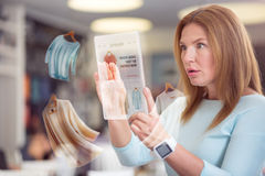 Surprised pleasant woman using tablet Stock Images