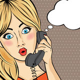 Surprised pop art  woman chating on retro phone . Comic woman wi Royalty Free Stock Photography