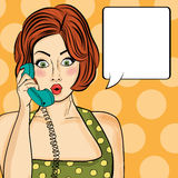 Surprised pop art  woman chatting on retro phone . Comic woman w Stock Photography