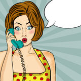 Surprised pop art  woman chatting on retro phone . Comic woman w Stock Images
