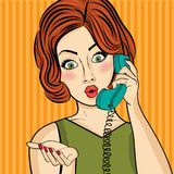 Surprised pop art  woman chatting on retro phone . Comic woman w Royalty Free Stock Image