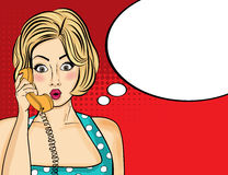 Surprised pop art  woman chatting on retro phone . Comic woman w Royalty Free Stock Photos