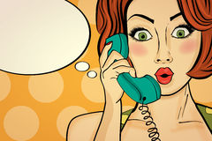 Surprised pop art woman chatting on retro phone . Comic woman wi Royalty Free Stock Images