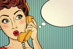 Surprised pop art woman chatting on retro phone . Comic woman wi Royalty Free Stock Photography