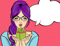 Surprised pop art  woman that holds a gift in their hands . Comi Stock Photography