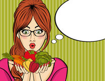 Surprised pop art  woman that holds vegetables  in her hands . C Stock Photo