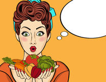 Surprised pop art  woman that holds vegetables  in her hands . C Royalty Free Stock Photo