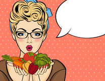 Surprised pop art  woman that holds vegetables  in her hands . C Stock Photography