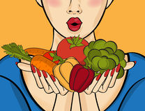 Surprised pop art  woman that holds vegetables  in her hands . C Stock Image