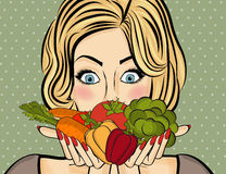 Surprised pop art  woman that holds vegetables  in her hands . C Stock Images