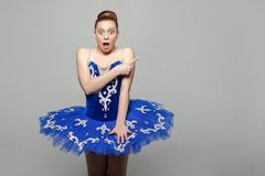 Surprised portrait of beautiful ballerina woman in blue costume stock images