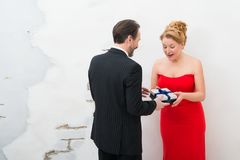 Surprised positive woman receiving a present from her husband stock photography