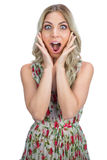 Surprised pretty blonde wearing flowered dress posing Royalty Free Stock Photography