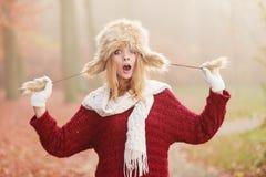 Surprised pretty fashion woman in fur winter hat Stock Photo