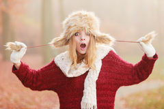 Surprised pretty fashion woman in fur winter hat Stock Image