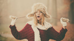 Surprised pretty fashion woman in fur winter hat Stock Photos