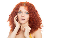 Surprised pretty girl with curly red hair Stock Photos