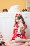 Surprised pretty girl posing with lots of sweets Stock Photo