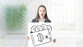 Surprised smiling young woman wearing a suit and looking at a cryptocurrency sketch on a design flat wall. Concept of stock photography