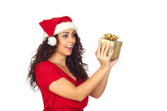 Surprised pretty woman in Christmas with a gift Royalty Free Stock Photo