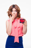 Surprised pretty woman holding gift box Royalty Free Stock Photos