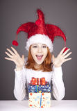 Surprised red-haired girl in christmas cap Royalty Free Stock Image
