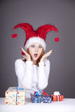 Surprised red-haired girl in christmas cap Royalty Free Stock Images