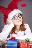 Surprised red-haired girl in christmas cap Stock Photography