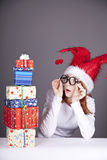 Surprised red-haired girl in christmas cap Stock Image