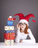 Surprised red-haired girl in christmas cap Royalty Free Stock Photos