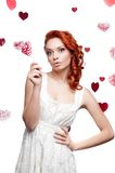 Surprised red-haired woman holding lollipop Royalty Free Stock Photography