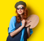 Surprised redhead girl with brush Stock Photography
