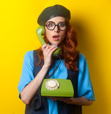 Surprised redhead girl with dial phone Stock Photos