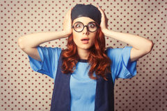 Surprised redhead girl in glasses Royalty Free Stock Photos