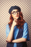 Surprised redhead girl in glasses Stock Images
