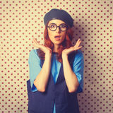 Surprised redhead girl in glasses Stock Photography