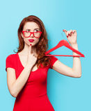 Surprised redhead girl with hanger Stock Image