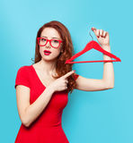 Surprised redhead girl with hanger Stock Photography