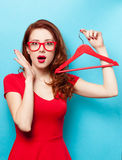 Surprised redhead girl with hanger Stock Images
