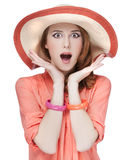 Surprised redhead girl in hat Stock Photography