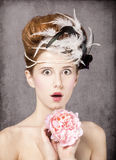 Surprised redhead girl with Rococo hair style Stock Image