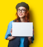 Surprised redhead girl with white board Stock Images