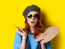 Surprised redhead painter with brush and palette Royalty Free Stock Photography