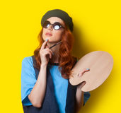 Surprised redhead painter with brush and palette Stock Image