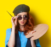 Surprised redhead painter with brush and palette Royalty Free Stock Photo