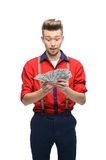 Surprised retro man holding money Stock Images