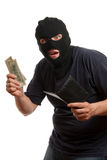 Surprised robber takes money from stolen wallet. Royalty Free Stock Photos