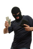 Surprised robber takes money from stolen wallet. Stock Images